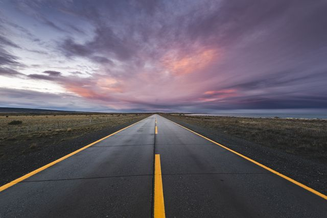 empty paved road at sunset in the chilean patagonia