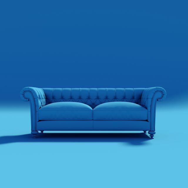 empty sofa against blue background