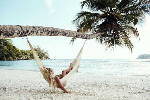 woman on beach in hammock