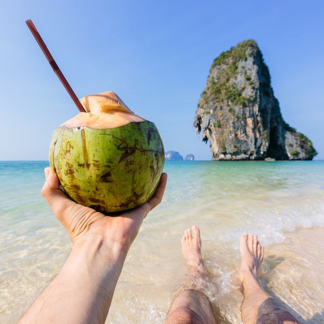 enjoying beach view and drinking coconut water, personal perspective view