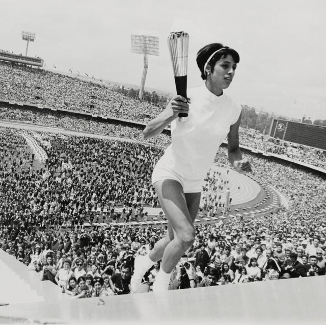 original caption a feminine first mexico city mexico's norma enriqueta basilio, the first woman in the history of the modern olympic games to light the olympic fire, runs up the ninety steps with the olympic torch during the opening ceremonies here october 12, 1968