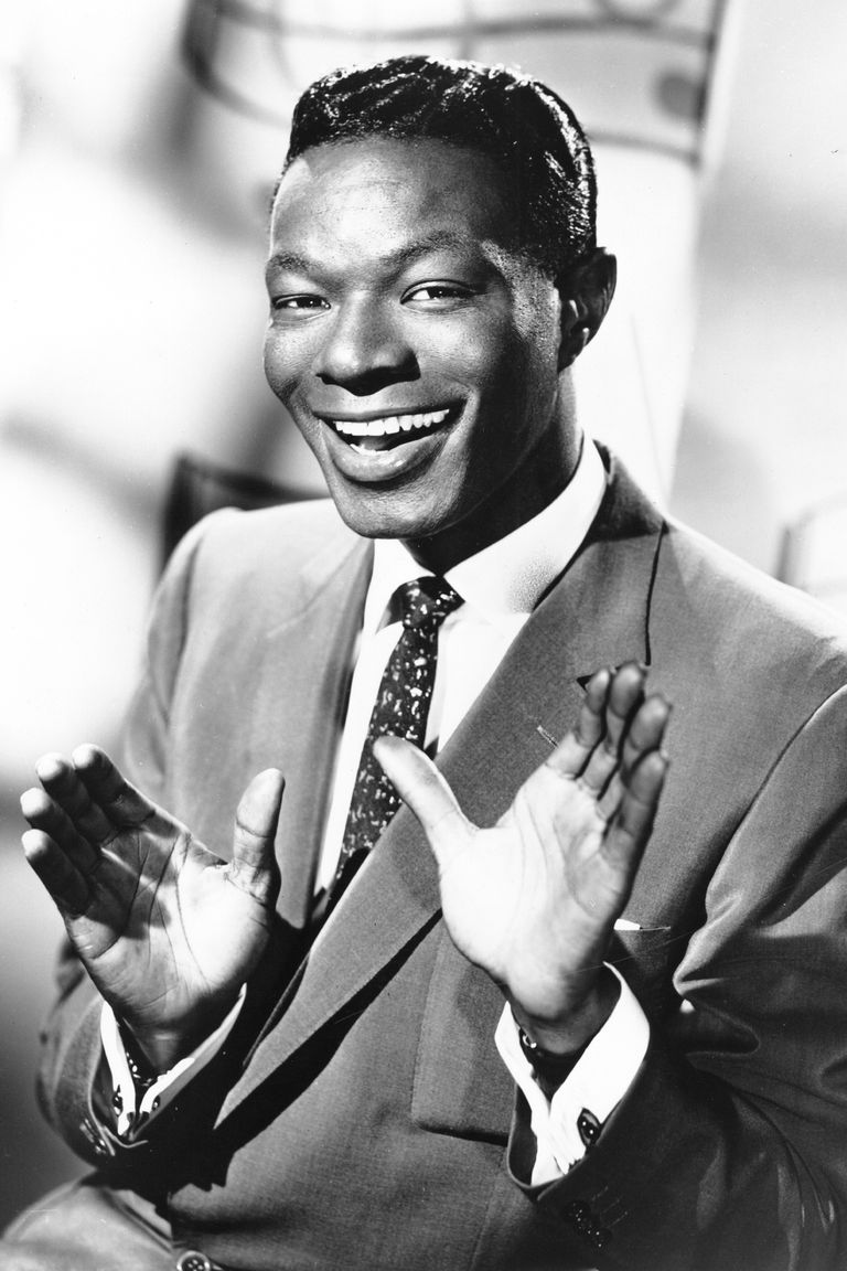 https://hips.hearstapps.com/hmg-prod.s3.amazonaws.com/images/entertainer-nat-king-cole-poses-for-a-portrait-in-circa-news-photo-1611348455.?crop=0.81824xw:1xh;center,top&resize=768:*