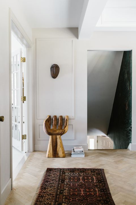 Hallway with hand-shaped chair