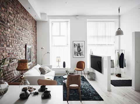 Salón.Apartamento de estilo nórdico renovado