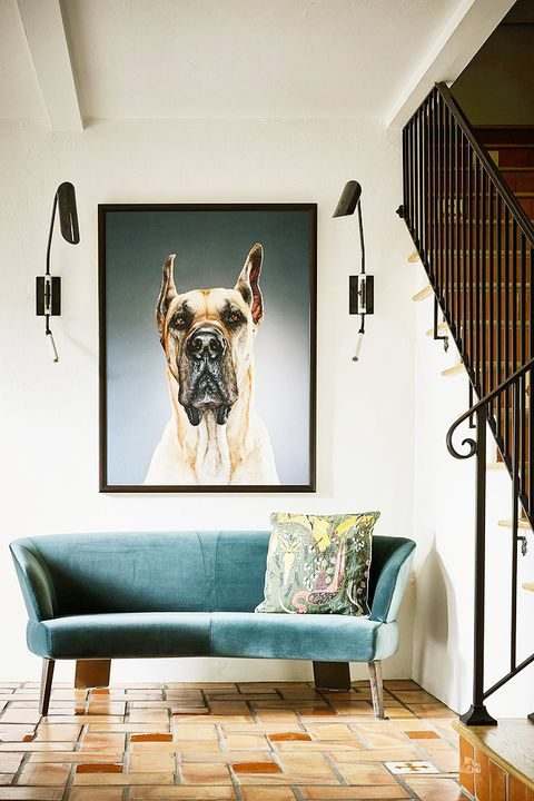 entryway with tile floors and dog portrait