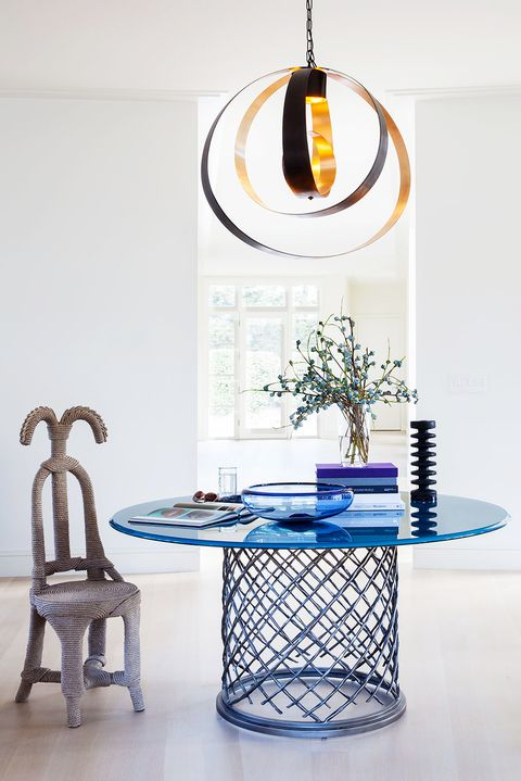 entryway with modern blue table, chair, and lamp