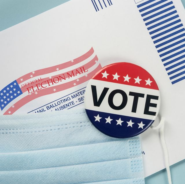 envelope, election pin and face mask against blue