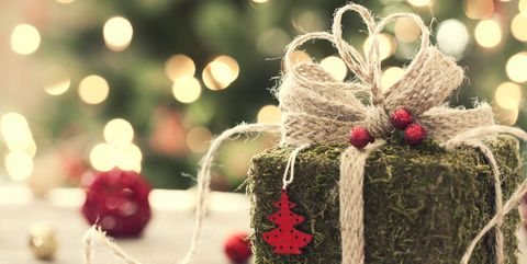 environmentally friendly christmas gift wrapped in moss