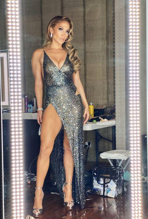 Clothing, Fashion model, Dress, Leg, Thigh, Shoulder, Fashion, Cocktail dress, Model, Long hair,
