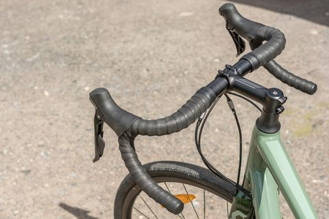 Ergonomically shaped handlebar of a road bike with brake lever and gear lever