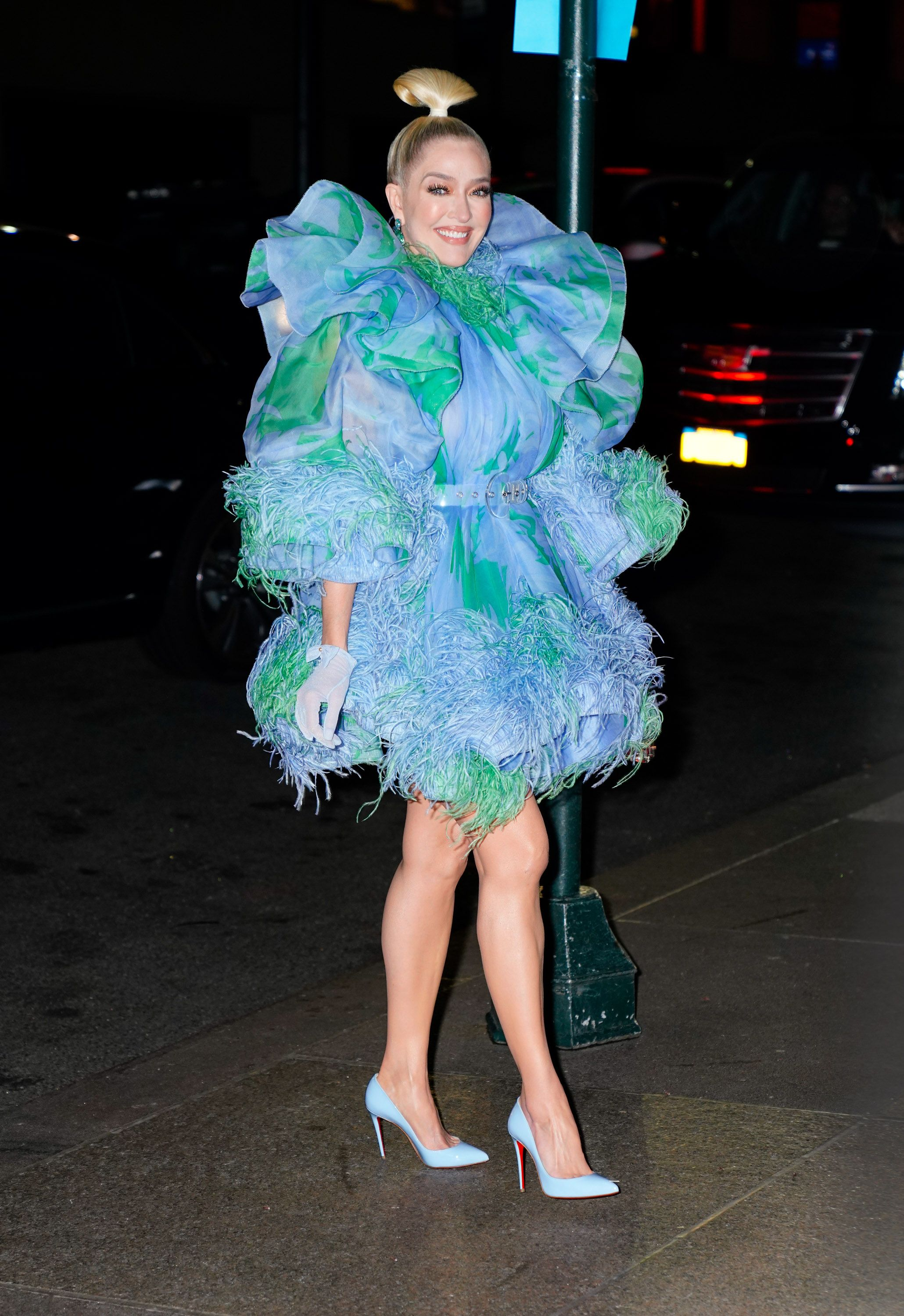 The reality star wore a striking blue and green puffy dress.