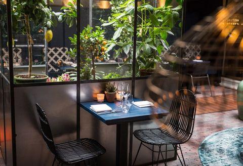 Property, Table, Room, Restaurant, Interior design, Lighting, Furniture, Patio, Building, House,