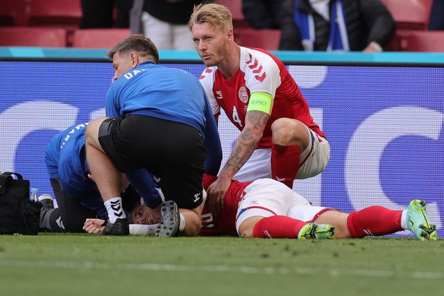 topshot   denmarks midfielder christian eriksen bottom c receives medical attention after collapsing on the pitch during the uefa euro 2020 group b football match between denmark and finland at the parken stadium in copenhagen on june 12, 2021 photo by friedemann vogel  various sources  afp photo by friedemann vogelafp via getty images