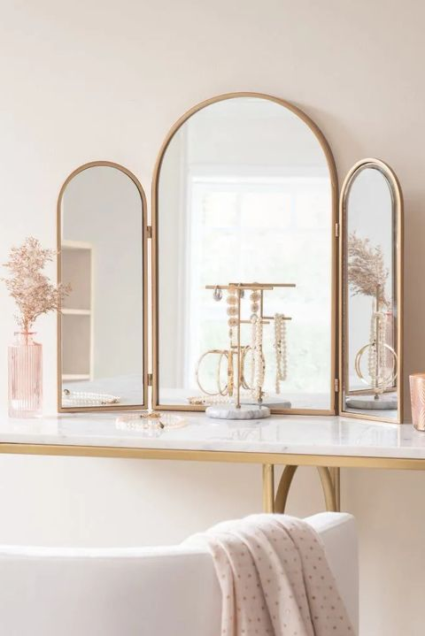 espejo tríptico de metal dorado