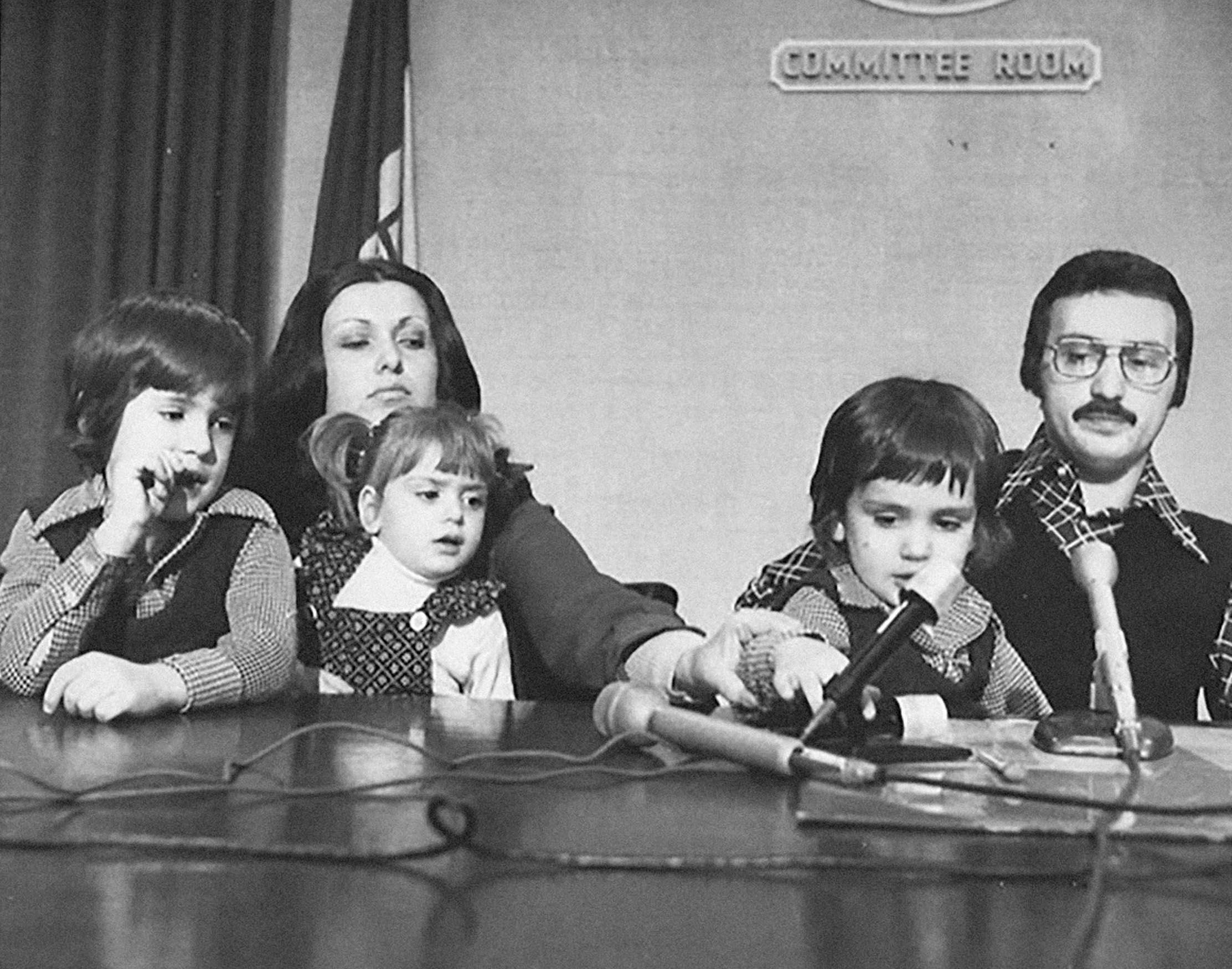 Anthony, left, and Joe in the mid-1970s, with their mother, Patricia; their sister, Gabriella; and their politician father, Basil, at Cleveland City Hall.