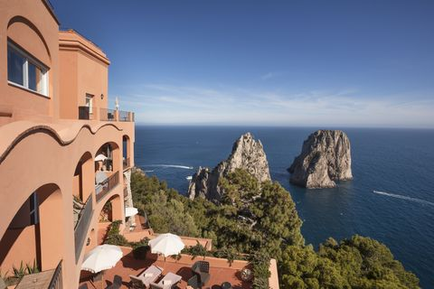 Sky, Sea, Coast, Azure, Tourism, Cliff, Promontory, Rock, Coastal and oceanic landforms, Terrain,