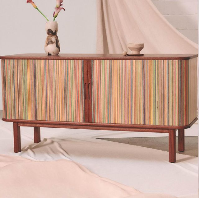 credenza made of skateboards and test tube chandelier with flowers