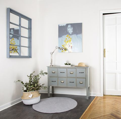 White, Furniture, Room, Interior design, Property, Floor, Yellow, Chest of drawers, Table, Wall,