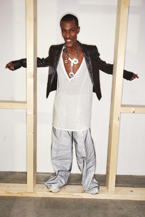 White, Fashion, Standing, Outerwear, Suit, Blazer, Room, Formal wear, Shoe, Fashion design,