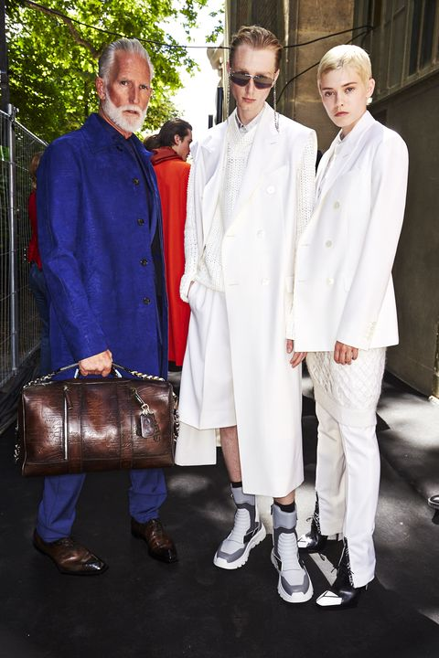 White, Fashion, Uniform, Suit, Outerwear, Event, Formal wear, Fashion design, Fashion accessory, Street fashion,