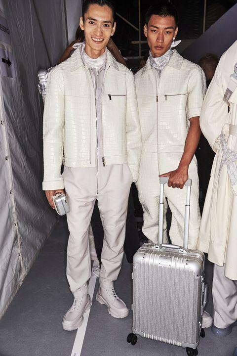 White, Fashion, Suit, Outerwear, Event, Fashion design, Haute couture, Uniform, Formal wear, Style,