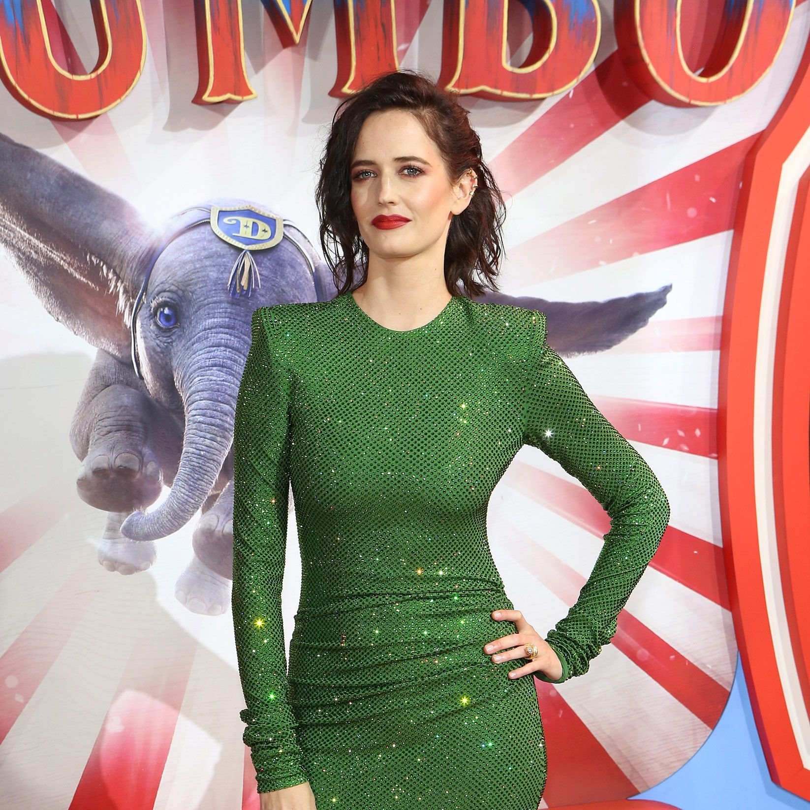 Dumbo's Eva Green hands her used chewing gum to an assistant on the red carpet