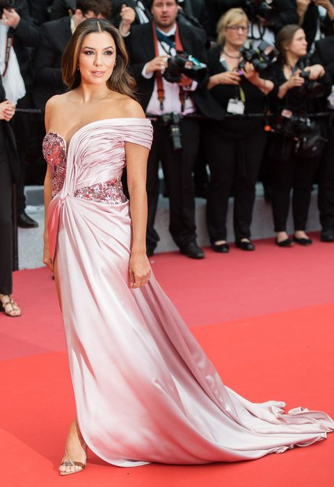 Fashion model, Red carpet, Dress, Gown, Carpet, Clothing, Shoulder, Flooring, Premiere, Fashion,