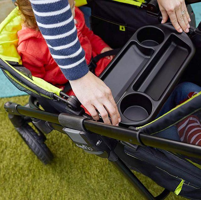 parent adjusting cup holder in evenflo wagon stroller