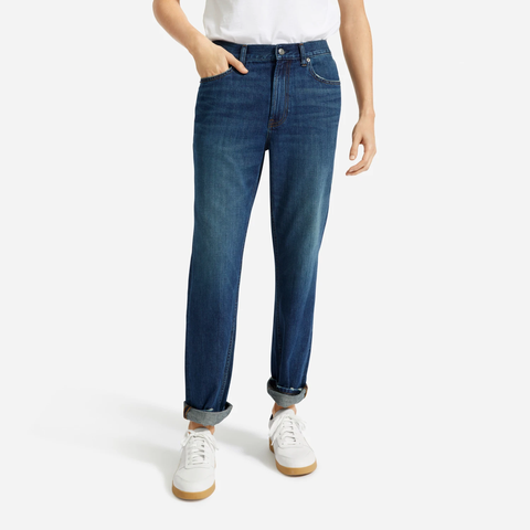 blue jeans and white sneakers on model