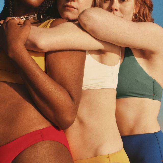 women wearing colorful everlane bikinis