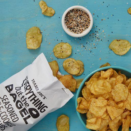 everything bagel seasoning snacks potato chips and seasoning on blue surface