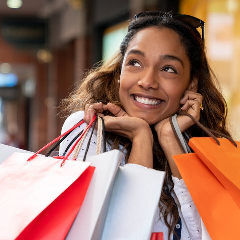 excited shopping woman looking very happy holding bags