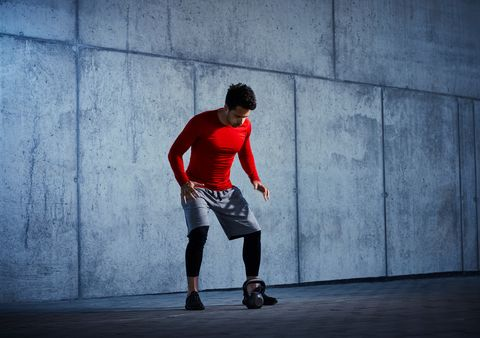 Exercise motivation concept -athlete clapping before kettlebell gym workout