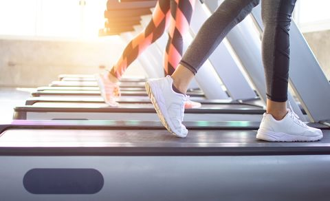 Exercise treadmill cardio running workout at fitness gym of woman taking weight loss with machine aerobic for slim and firm healthy in the morning.Show of running shoes, rubber floor, softness,