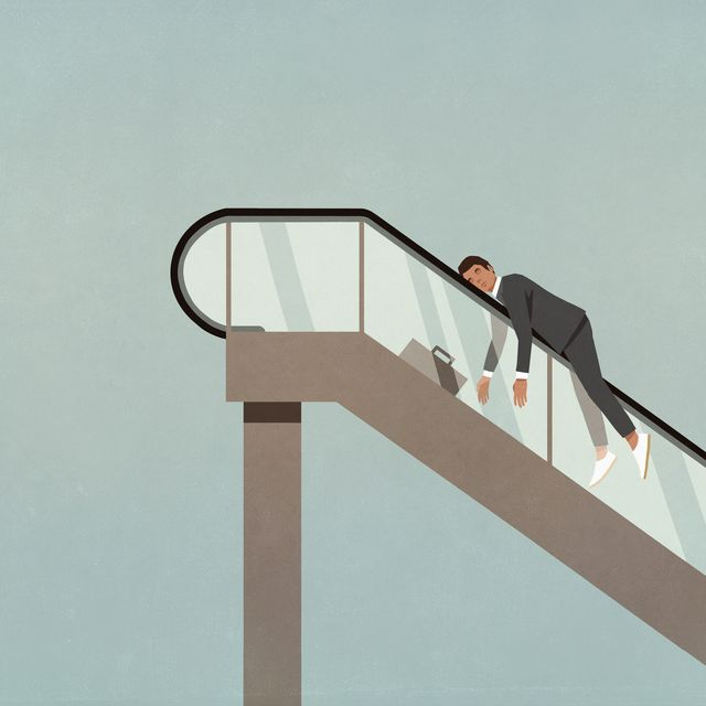 exhausted businessman on ascending escalator