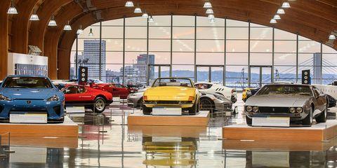 Land vehicle, Vehicle, Car, Car dealership, Automotive design, Yellow, Building, City car, Floor, Supercar,
