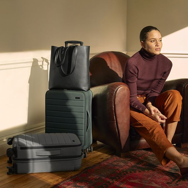 Massage chair, Hardwood, Sitting, Baggage, Leg, Floor, Flooring, Furniture, Room, Comfort,