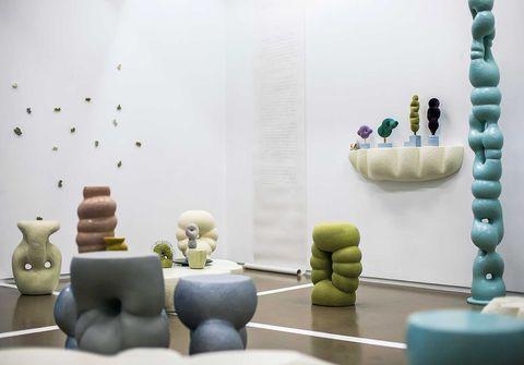 Interior design, Room, Ceramic, Furniture, Living room, Design, Flowerpot, Architecture, Table, Vase,