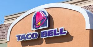 Exterior of Taco Bell fast-food restaurant with sign and logo