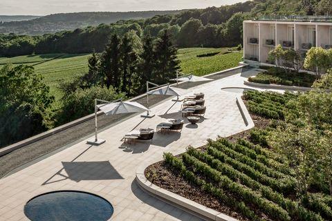 Property, Landscape, Architecture, Urban design, Tree, Shrub, Roof, Garden, House, Grass,