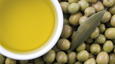 Extra virgin pure olive oil and olives