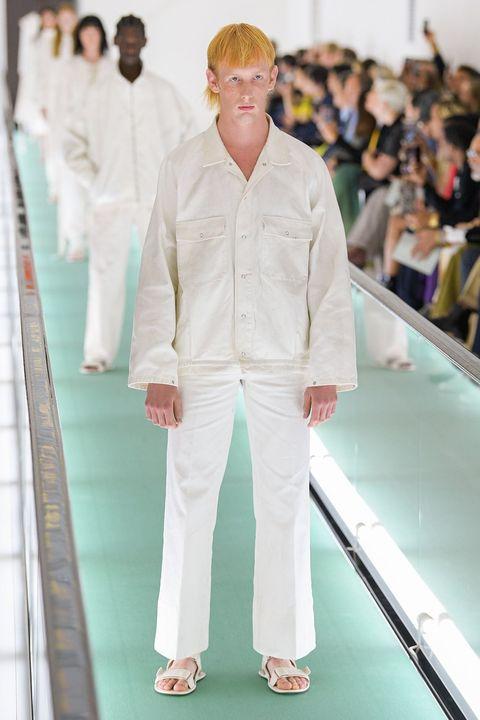 White, Fashion, Suit, Footwear, Human, Eyewear, Runway, Outerwear, Fashion design, Fashion show,