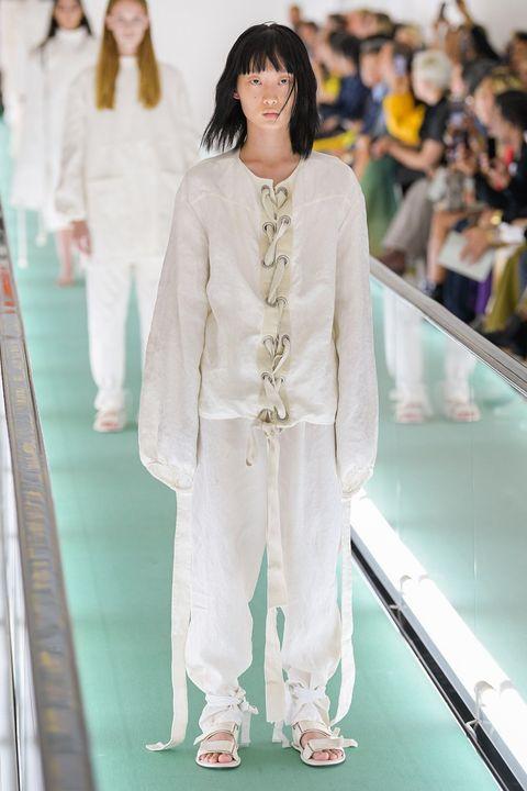 Fashion, Fashion model, White, Fashion show, Clothing, Runway, Haute couture, Fashion design, Outerwear, Dress,