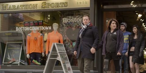 Robert Fogarty walks out of Marathon Sports with Celeste Corcoran