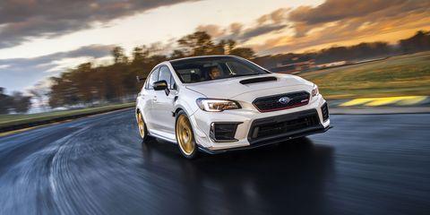 Land vehicle, Vehicle, Car, Automotive design, Full-size car, Rim, Wheel, Rolling, Subaru, Automotive wheel system,