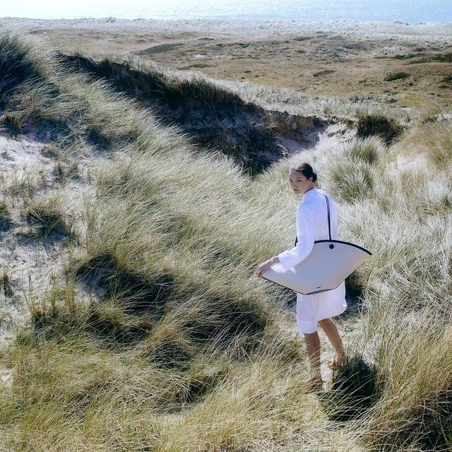 Grass, Sky, Ecoregion, Grassland, Sand, Photography, Coast, Landscape, Vacation, Plant community,