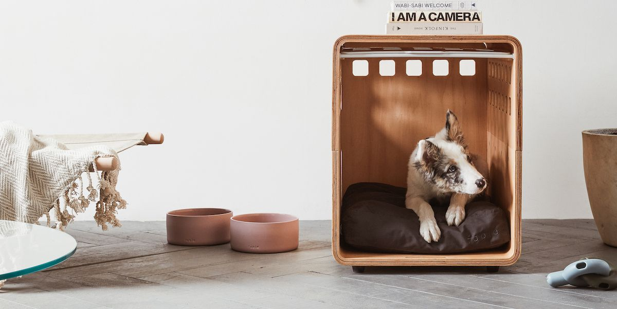 stylish wooden dog crate in living room