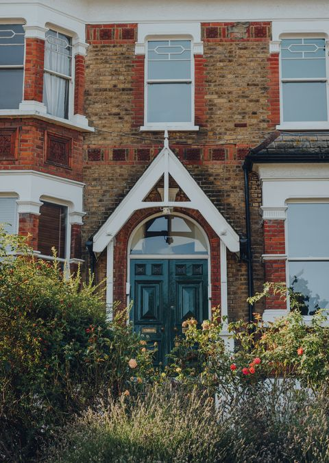 london, uk   august 20, 2020 facade of a traditional terraced house in crouch end, an area in north london traditionally favoured by creatives and families, view over the greenery