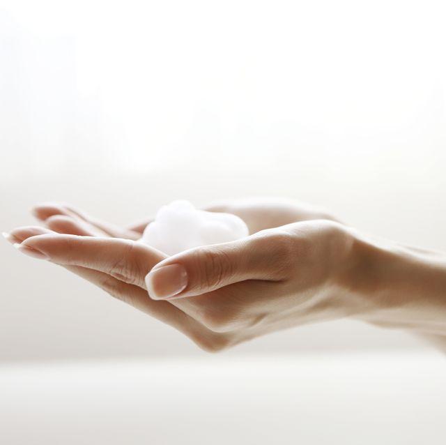 face wash foam on hands