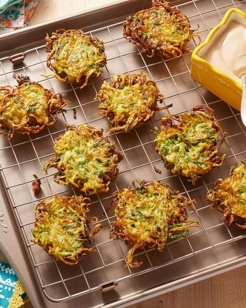 zucchini fritters on wire rack with crema